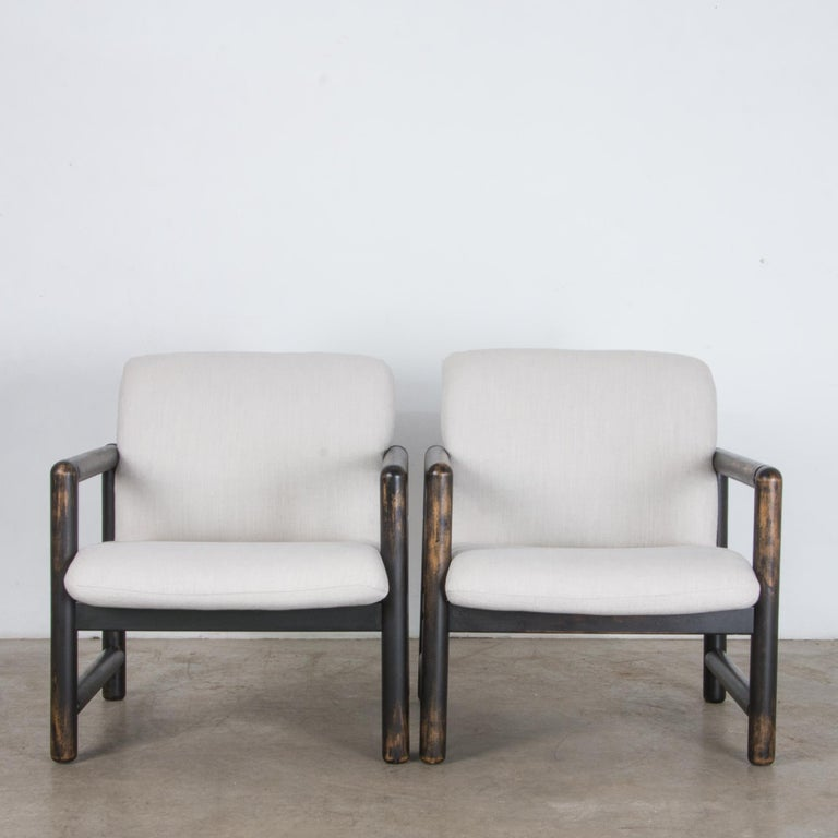 Manufactured by TON, a pair of stylish and comfortable armchair in distinct Modernist style from Czech Republic, circa 1980. A timeless approach that still looks contemporary and fresh. This chair features a minimal cubic frame. Patinated hardwood