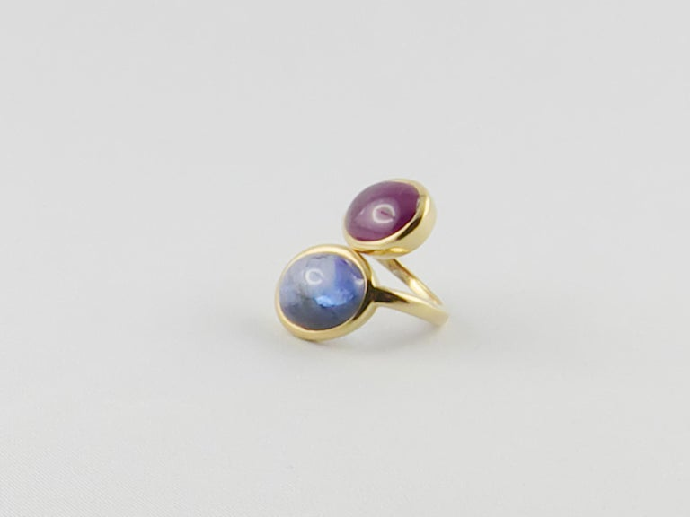 Old David Webb Ruby and Sapphire Cabochon  18 karat Gold  Ring The two gorgeous gems, set in a tapering crossover shank, mounted in 18ct Yellow Gold give an extremely elegant, glamourous and sophisticated look. This delightful  Crossover Ring can be