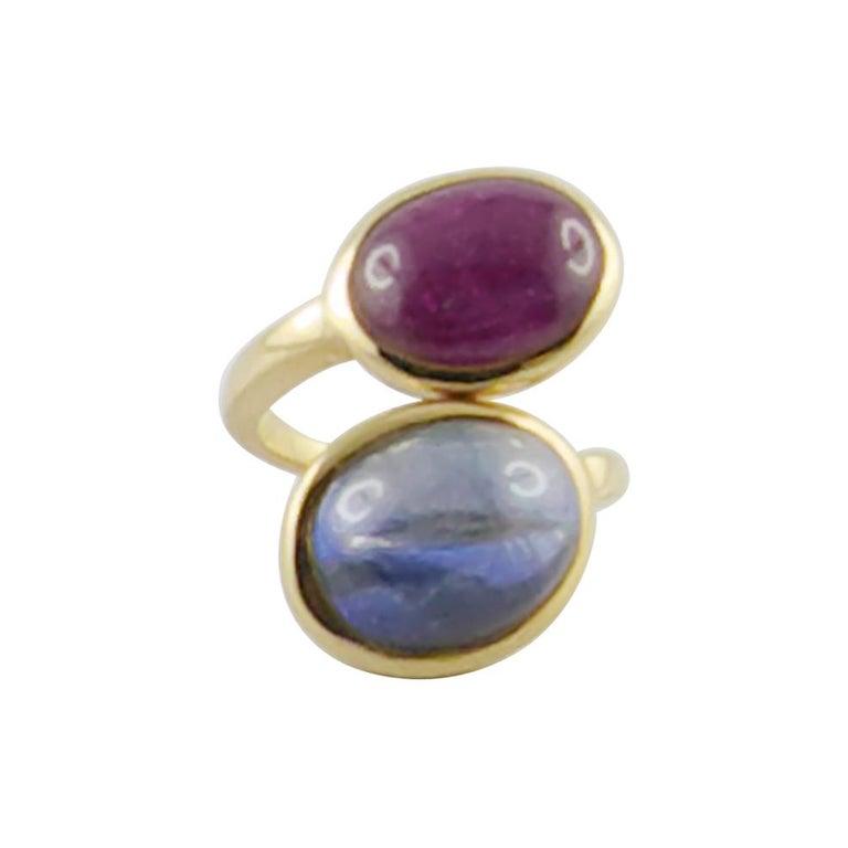 1980s David Webb Ruby Sapphire 18 Karat Gold Crossover Ring For Sale