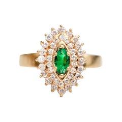 1980s Diamond and Emerald 18 Karat Yellow Gold Ring