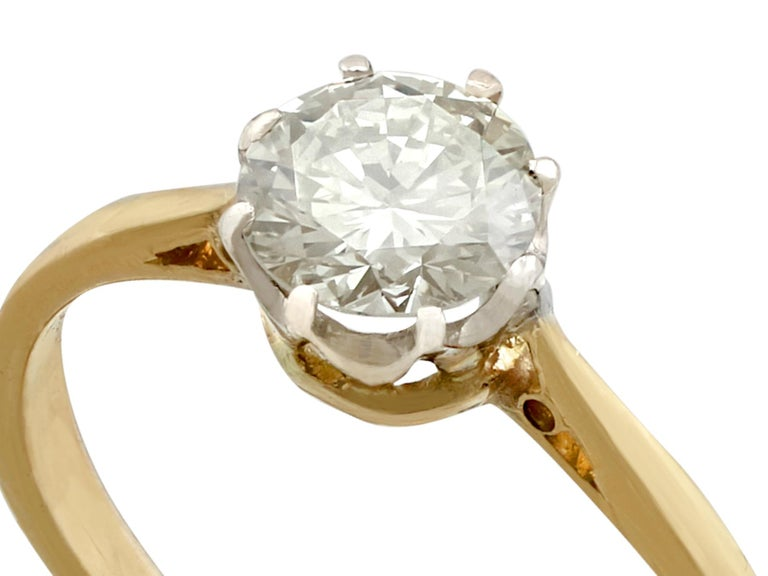 An impressive vintage 0.65 carat diamond and 18 carat yellow gold, 18 carat white gold set engagement ring; part of our diverse diamond jewellery and estate jewelry collections.  This fine and impressive gold diamond solitaire ring has been crafted