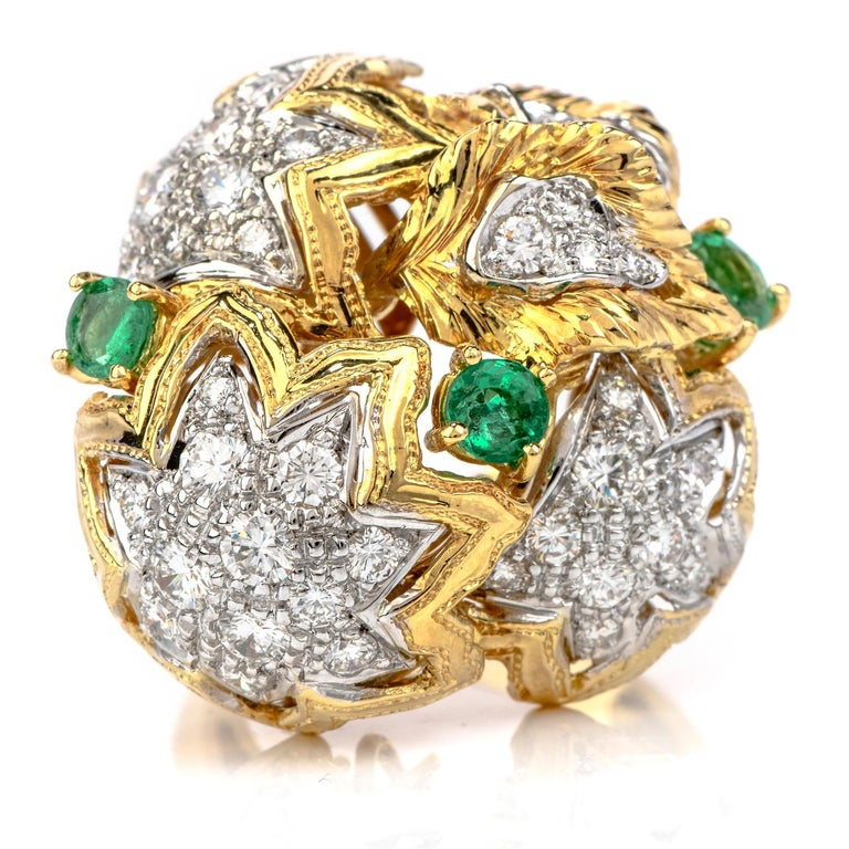 Every person needs a fun and noticeable cocktail ring in their collection.  This 1980's Diamond Emerald 18K Gold Large Star Cocktail Ring would be that perfectly beautiful addition!   This bursting ring has star motifs and is crafted in 18 karat