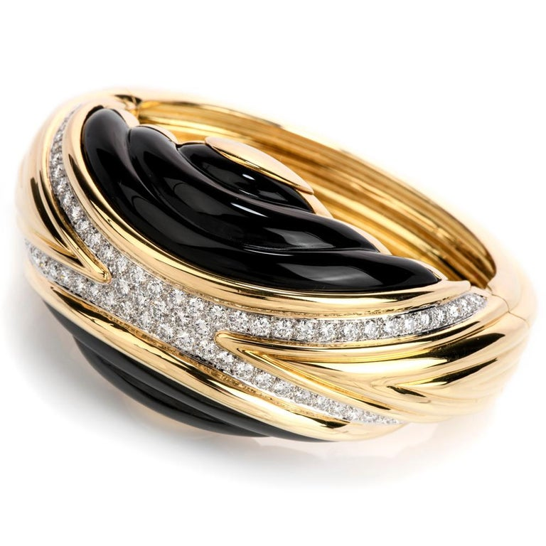Treat yourself with this trending Chic early 1980's Diamond & Onyx large bangle bracelet. It  is crafted in 18K yellow gold, topped with extra white natural diamonds, pave set.  Material: 18K yellow gold  Dimensions: 3
