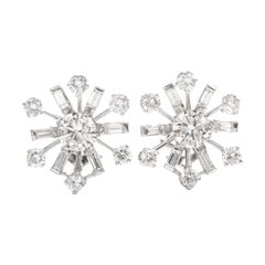 1980s Diamond Platinum Pinwheel Clip Earrings