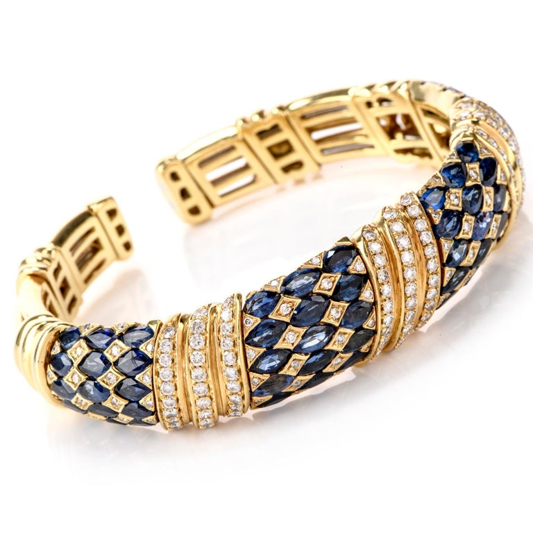This Regal Diamond and Sapphire bracelet is sure to make  a Statement in any room. Wide throughout and flexible to access, this bracelet has 4 defined links with Jester patterns of  Sapphire and Diamond  and 3 separating links of diagonal prong set