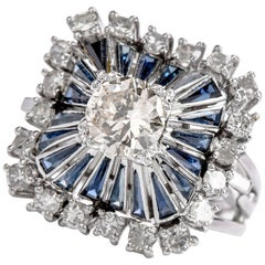 1980s Diamond Sapphire Square Pinwheel Platinum Cocktail Ring