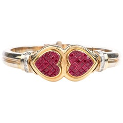 1980s Double Heart Ruby Diamond 18 Karat Gold Bangle Bracelet