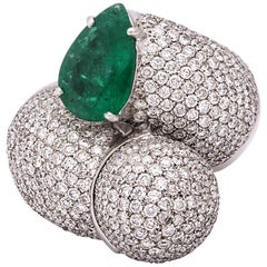 1980s Dramatic Pear Shaped Emerald with Diamond Bypass Gold Cocktail Ring