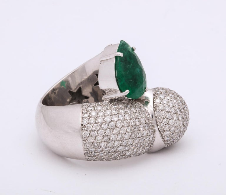 Women's 1980s Dramatic Pear Shaped Emerald with Diamond Bypass Gold Cocktail Ring For Sale