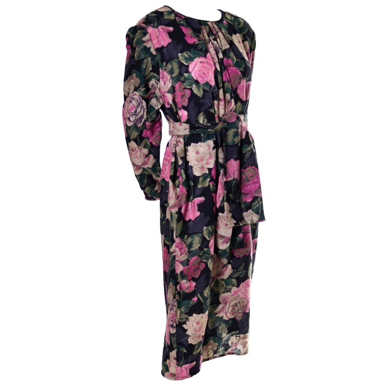 This great vintage late 1980's dress was designed by Emanuel Ungaro and bears the Ungaro Ter label.  We love the gorgeous pink and cream floral print .This pretty vintage black Ungaro  dress is made of 90% wool and 10% nylon and it has slight