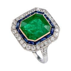 1980s Emerald Diamond Sapphire Platinum 18 Karat Gold Cocktail Ring