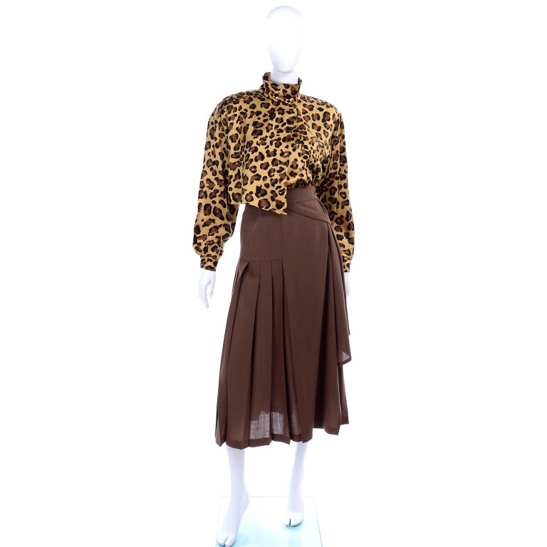 This is an incredible 2 piece Escada ensemble designed by Margaretha Ley in the 1980's. This outfit came from an estate of clothing we handled that included the best of the 1980's and many unique Escada pieces.  This has a chocolate brown wool poly