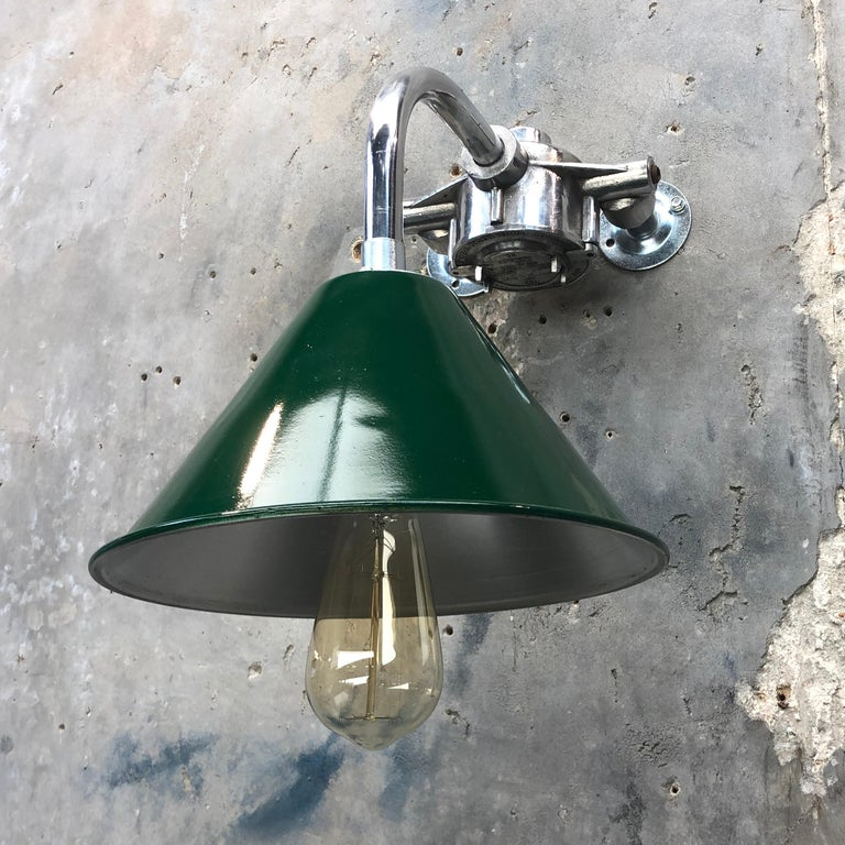 An ex British army festoon lamp shade and galvanized cantilever wall lamp with double wall fixing to allow a longer reach.