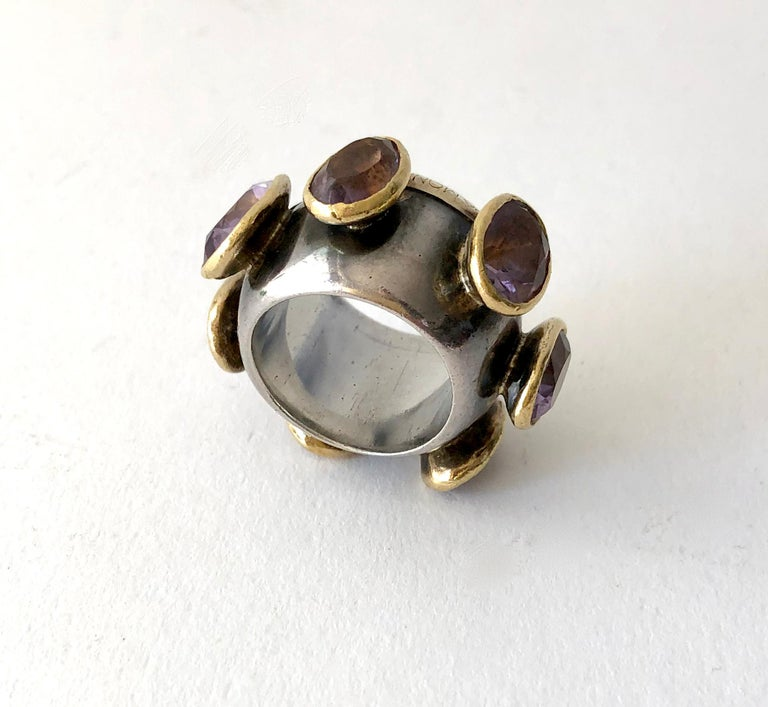 Chunky amethyst, sterling silver and 23K gold ring created by Gerda Lyndgaard Monies of Copenhagen, Denmark.  Ring is a finger size 7 - 7.5 and is 5/8