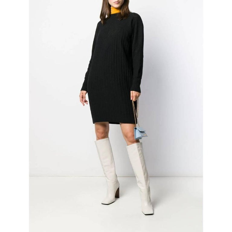 Gianni Versace knitted black angora and wool blend dress/maxi-sweater. Round neckline and long sleeves. Loose fit. Years: 80s  Made in Italy  Size: 44 IT  Flat measurements  Height: 94 cm Bust: 50 cm Shoulders: 40 cm Sleeves: 61 cm