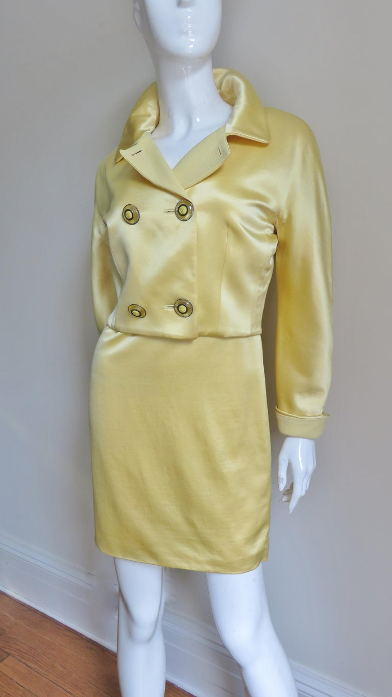 A pretty soft yellow silk and wool dress and jacket set from Gianni Versace's istante collection. The sleeveless scoop neck fitted dress is simply cut with a matching yellow light weight wool upper bodice front and back and yellow silk skirt potion.