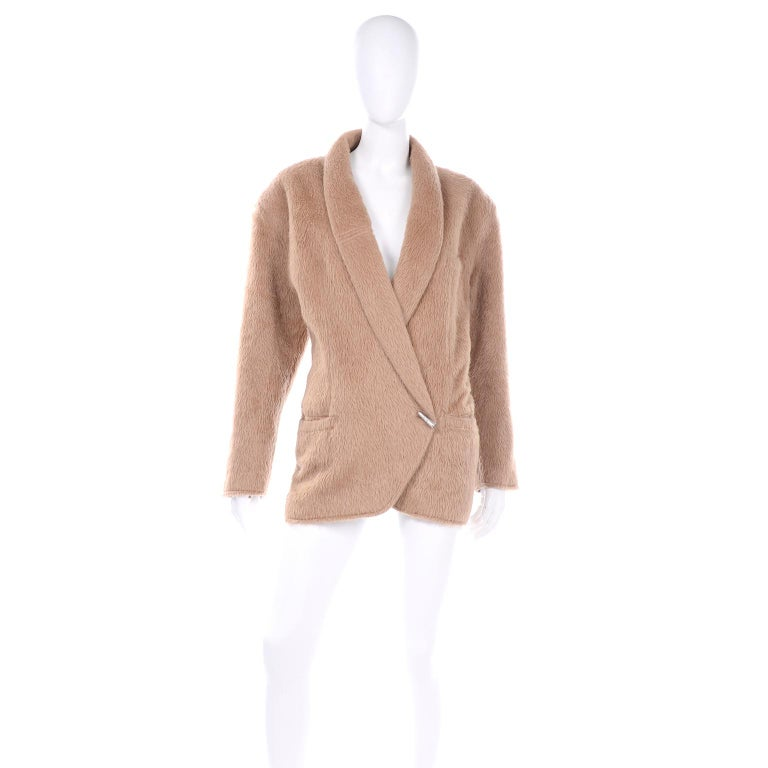 This 1980's vintage Gianni Versace oversized jacket is absolutely amazing! We love the fuzzy camel color alpaca wool blend for this particular silhouette.  This jacket has shoulder pads, 3 functional pockets and an internal button closure to create