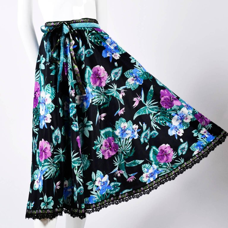 This floral cotton vintage skirt was designed by Giorgio di Sant' Angelo and is embellished with colorful sequins and trimmed at the hemline with lace and embroidered ribbon.  The skirt was purchased at I Magnin in the late 1980's and has its