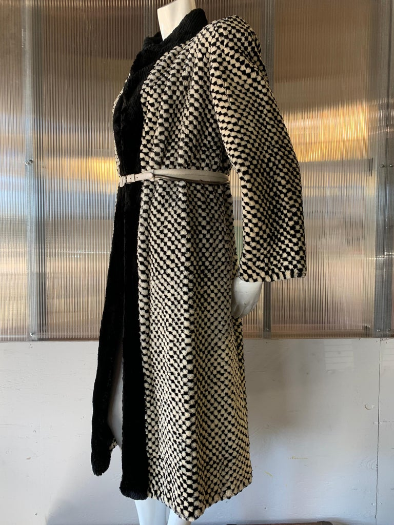 1980s Givenchy Couture Checkerboard Sheared Beaver Coat with Black Fur Front Trim. Exquisitely hand-pieced and finished. Banded collar and front trim in sheared beaver also. Belt included but not original.