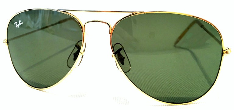 1980'S Gold Plate Tear Drop Aviator Sunglasses & Case By, Bausch & Lomb Ray Ban USA. These classic and timeless tear drop shape aviator sunglasses feature, gold plate frame with military green/gray lens. The tear drop shaped lenses are