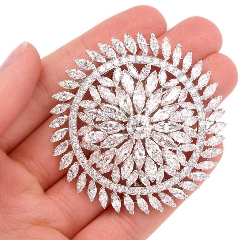 This immaculately crafted 1980's Grand lapel brooch and pendant is designed as an openwork orbicular plaque, rendered in solid platinum. This exquisite and versatile piece of jewelry is centered with an approx. 1.70 carats genuine round