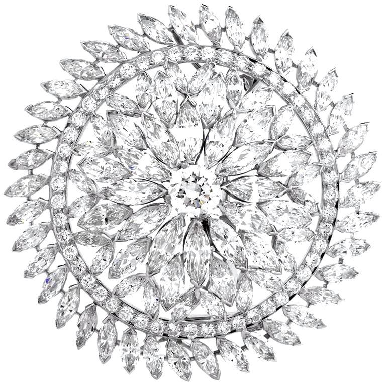 1980s Grand Blink Circular Diamond Platinum Lapel Brooch Pin For Sale