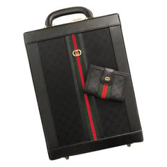 1980s Gucci black monogram web stripe vertical briefcase with matching wallet