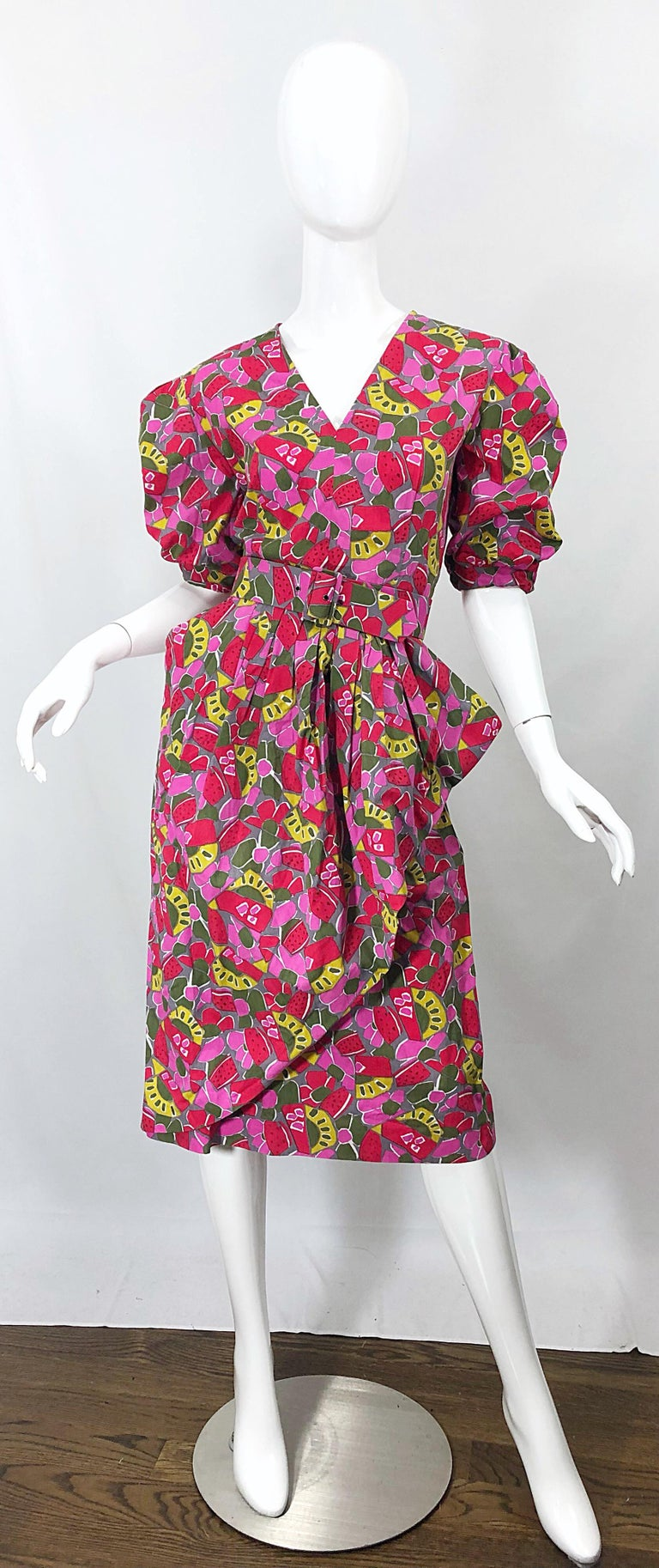 Chic 1980s GUY LAROCHE novelty fruit print Avant Garde cotton belted dress! Stylish puff sleeves, with a side peplum. Pockets at each side of the hips. Hidden zipper up the back with  hook-and-eye closure. Prints of watermelon, kiwi, strawberries,