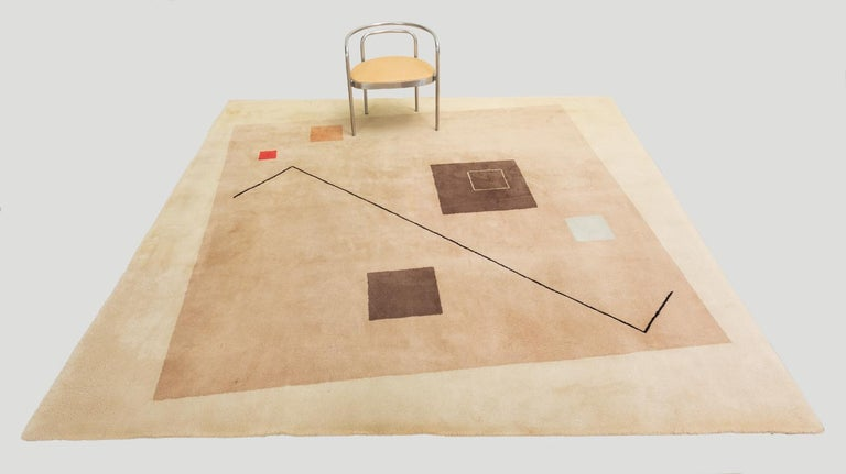 A large square carpet produced in France for Italian textile company Tisca. This collection of hand-tufted rugs featured Eileen Gray-esque configurations of elegantly disjointed geometry in 100% wool fiber. The Minimalist design has a large taupe