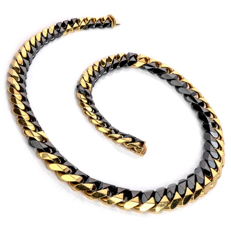 Fine 1980's heavy solid solid state Curb link chain necklace is crafted in 18K yellow &  solid 18k black gold.  Material: 18K gold  Weight: 108.6 grams  Dimensions: 16 1/2