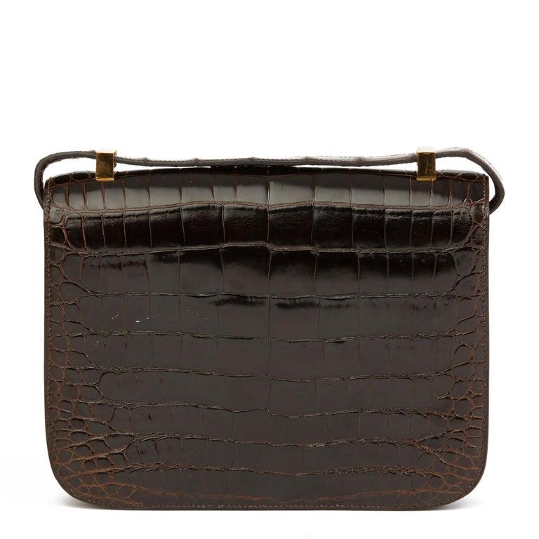Black 1980's Hermes Marron Fonce Shiny Caiman Crocodile Leather Vintage Constance 24 For Sale