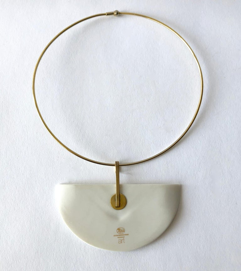 1980s porcelain half moon on gold tone metal necklace created by Hutschenreuther of Germany.  Pendant measures 2