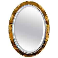1980s Italian Beveled Amber and Clear Oval Mirror by Crystal Arte