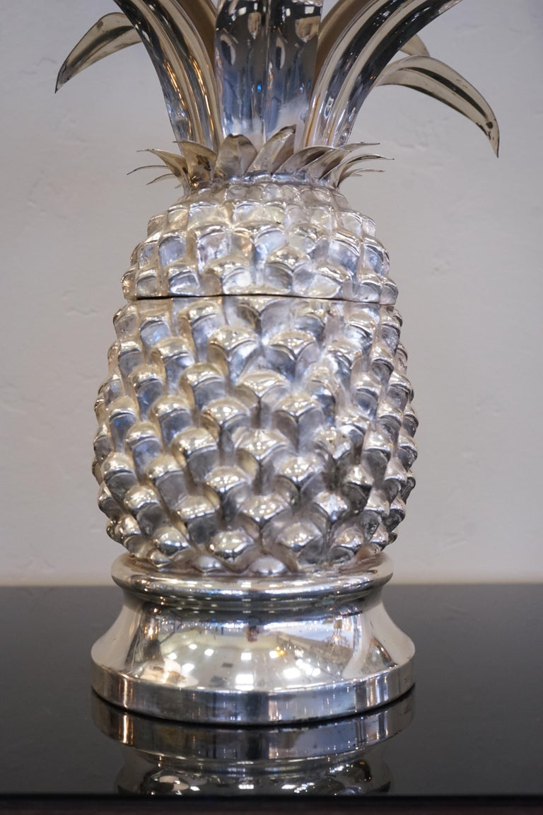 1980s Italian chrome large scale pineapple shaped ice bucket. The top of the pineapple opens to reveal an ice bucket but is also a stand-alone art piece when closed.