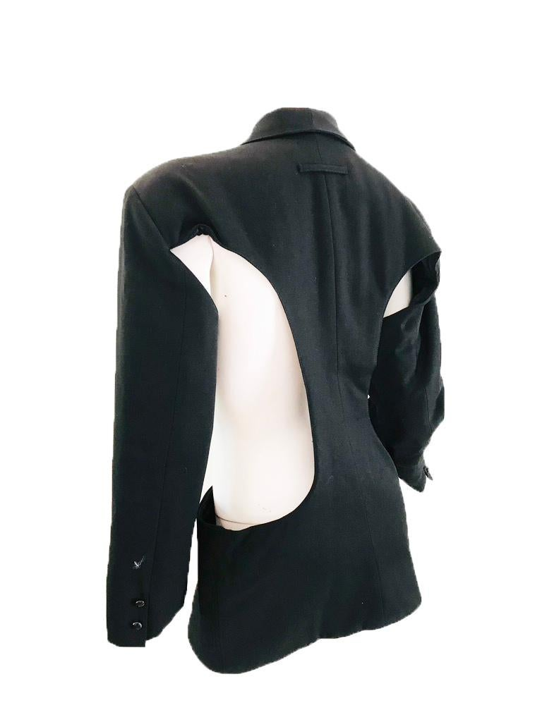 1980s Jean Paul Gaultier cut out blazer.   Front pockets Button closure in front Made in Italy 28