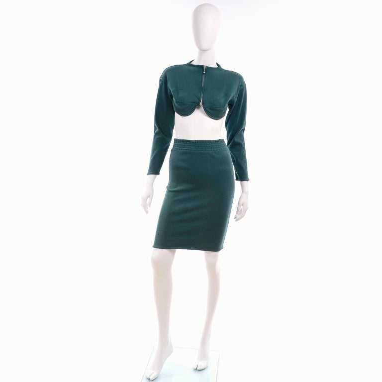 We absolutely adore this vintage late 1980's Jean Paul Gaultier Public outfit!  This two piece bare midriff ensemble is in a rich deep shade of green and is in an iconic Jean Paul Gaultier style.  This knit 2 pc dress includes a cropped bustier