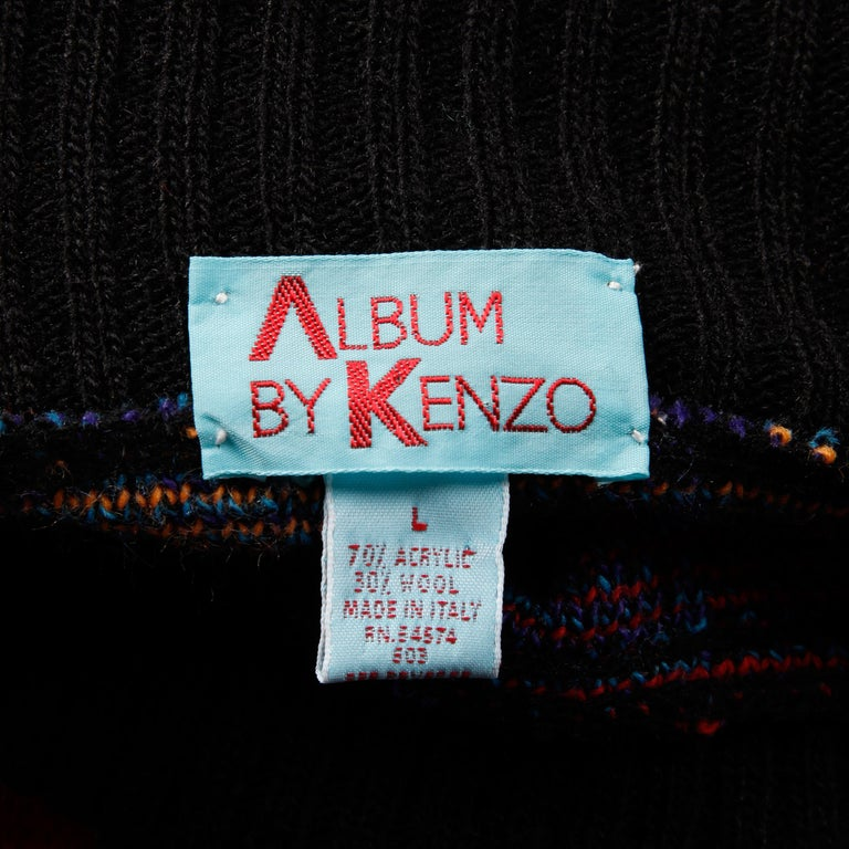 Vintage 1980s knit pullover sweater or jumper by Kenzo with colorful checkers and stripes. Unlined with no closure (pulls on over the head). The marked size is large. 70% acrylic, 30% wool. The bust measures 55