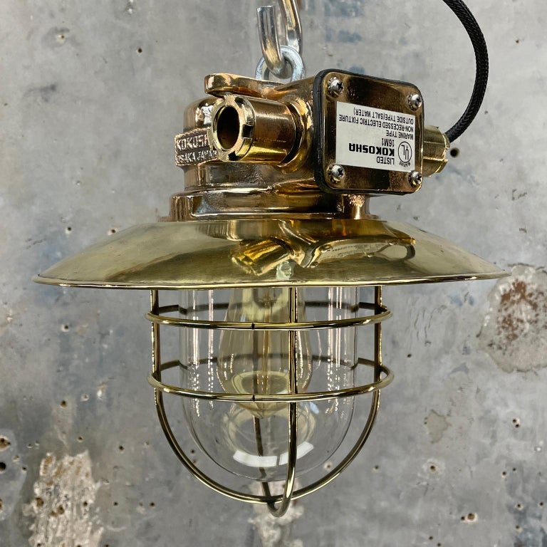 A cast bronze marine Industrial ceiling pendant lamp originating from Osaka Japan made by Kokosha who are a manufacturer of fixtures and fittings for hazardous areas within the marine industry.  These fixtures have been expertly restored with a