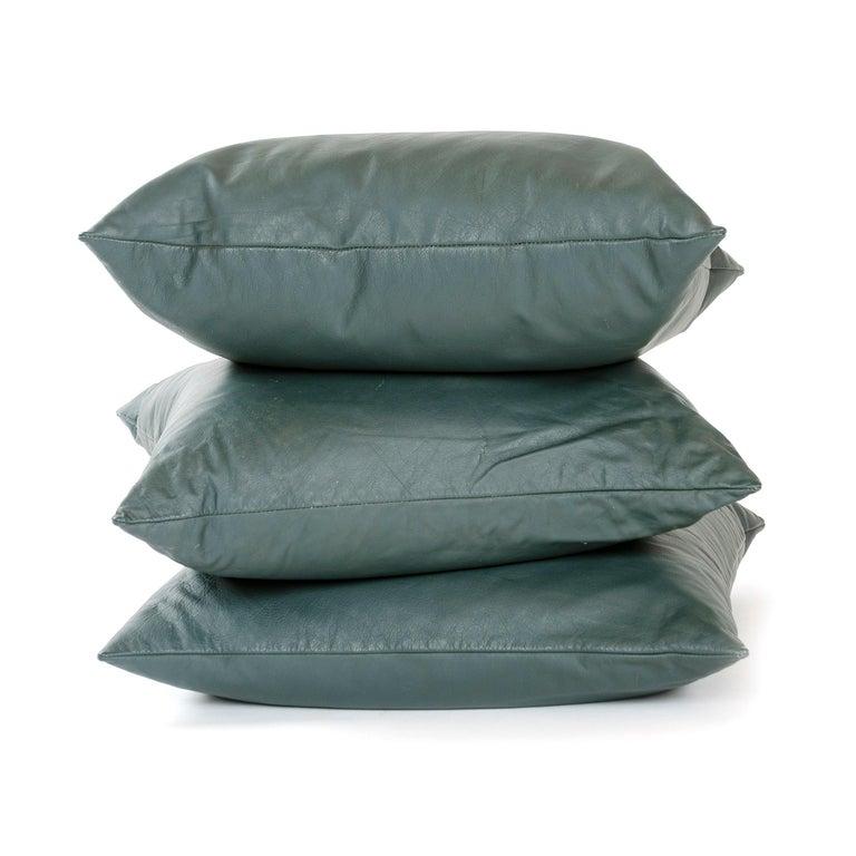 A handmade green leather pillow.