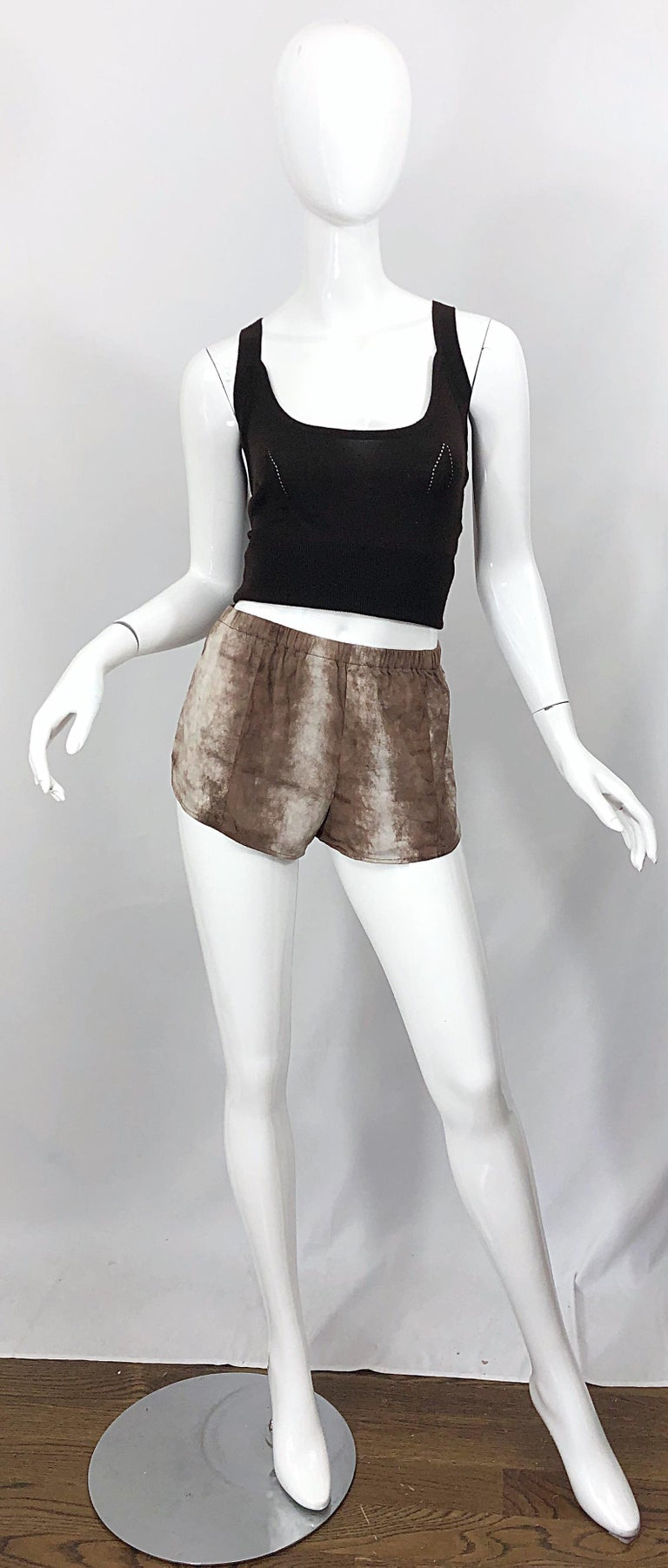 Amazing and collectible LOVE, MELODY early 80s sheepskin leather hot pants / shorts! Super soft ombre brown and taupe sheepskin leather with an elastic waistband that stretches to fit. Track style that is so on trend right now! The brown cashmere