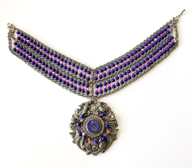 Handmade, one of a kind vintage 1980's banner style necklace with a large embellished glass beaded medallion designed and created by Mark Merrill of Detroit, Michigan.  Necklace portion measures 14