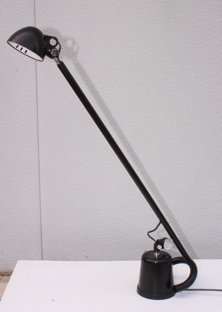 1980s adjustable Italian desk lamp, in vintage original condition. Well made and very heavy.
