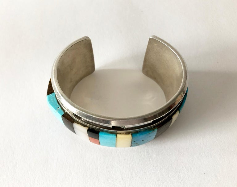 Vintage Navajo colorful mosaic inlay bracelet by artist DM.  Bracelet is well made and does have some heft to it.  It measures 1 3/8