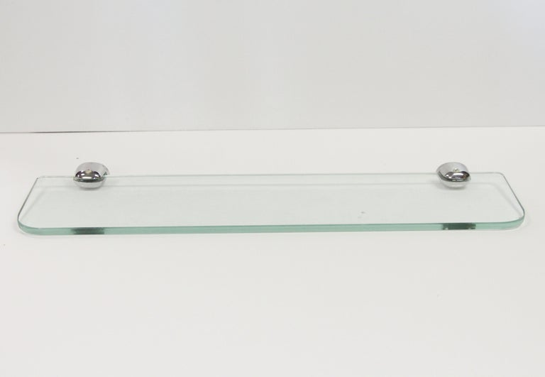 1980s NYC Waldorf Astoria Hotel clear glass horizontal bathroom shelf with nickel-plated brackets. A Waldorf Astoria authenticity card included with your purchase. Small quantity available at time of posting. Priced each. This can be seen at our 302