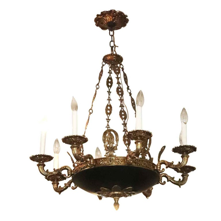 1980s Napoleon III Empire style eight-arm chandelier with crest fleur-de-lis design. These chandeliers originally graced the corridors of the towers of the NYC Waldorf Astoria Hotel. Possible variations in details such as finial, chain or canopy.