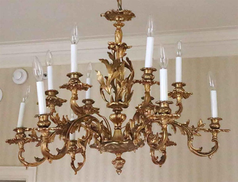 1980s NYC Waldorf Astoria Hotel organic gold gilt cast bronze filigree 12 arm chandelier from the Waldorf Astoria Towers. The gold gilt shows some wear, but adds to the charm of this historic chandelier. A Waldorf Astoria authenticity card included