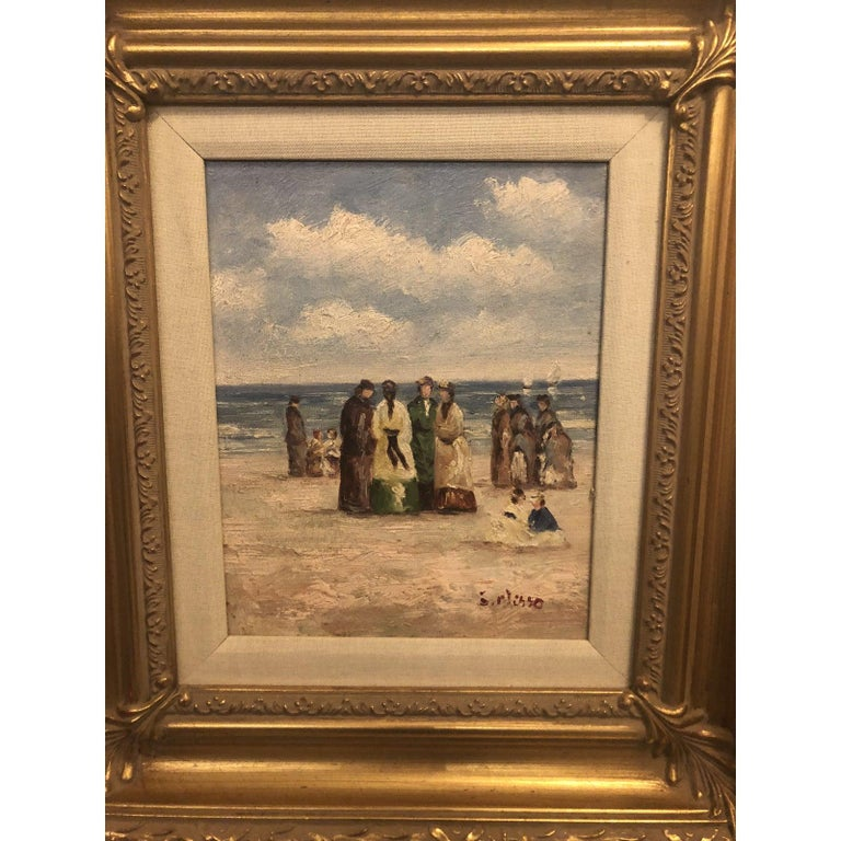 This is an oil on canvas painting depicting a group of people, seaside. The gilt frame is finely hand carved. 