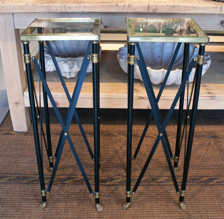 1980s pair of French designed bronze auxiliary tall tables with lion claw feet.