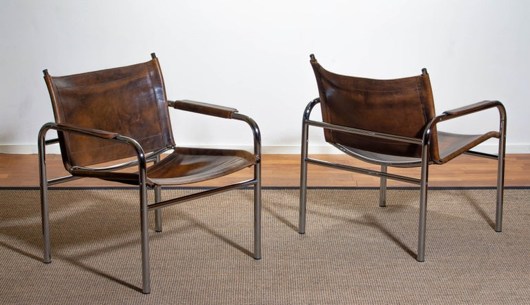 Swedish 1980s, Pair of Leather and Tubular Steel Armchairs by Tord Bjorklund, Sweden For Sale