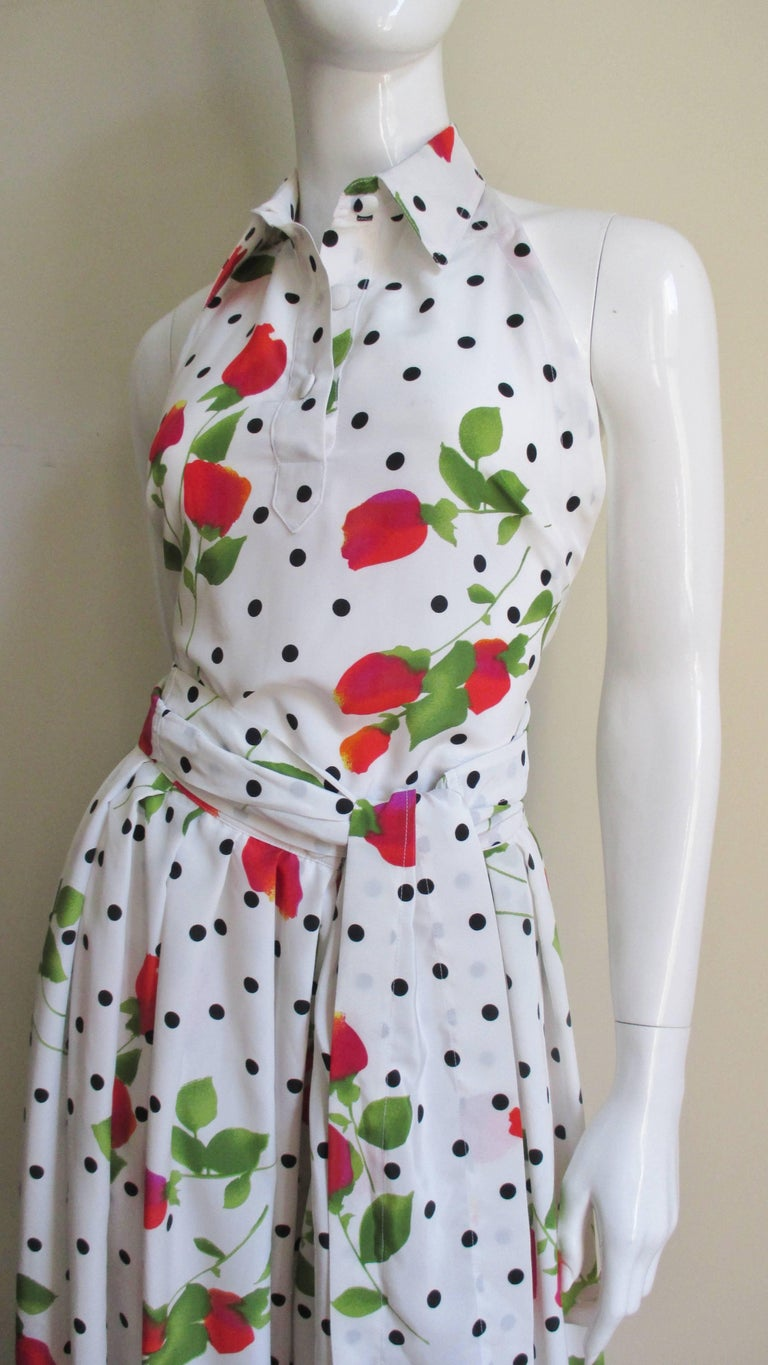 This set is from the short but brilliant career of designer Patrick Kelly and one of his notable ad campaigns.  It is a three piece set consisting of wrap halter top, wide leg pants and a double breasted jacket with red/orange/pink flowers and green